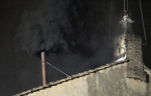 Black smoke rises from the chimney on the roof of the Sistine Chapel, where cardinals are gathered to elect the new pope, at the Vatican.