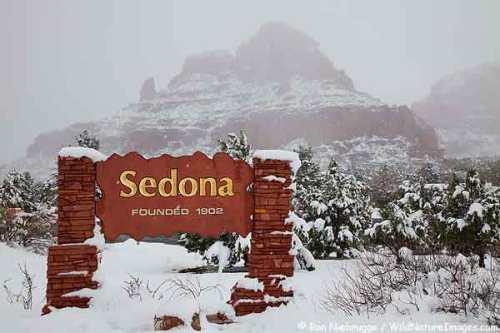 Winter snow on the welcome sign, Sedona, Arizona.