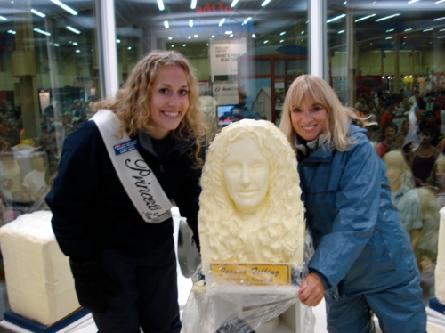 Jeanna Felling and Linda Christensen pose next to a butter head sculpture at the 2008 Minnesota State Fair.  CREDIT: Midwest Dairy Association